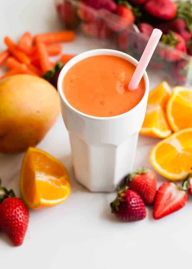 Coconut Water Smoothie with Mango and Strawberry | HelloGlow.co