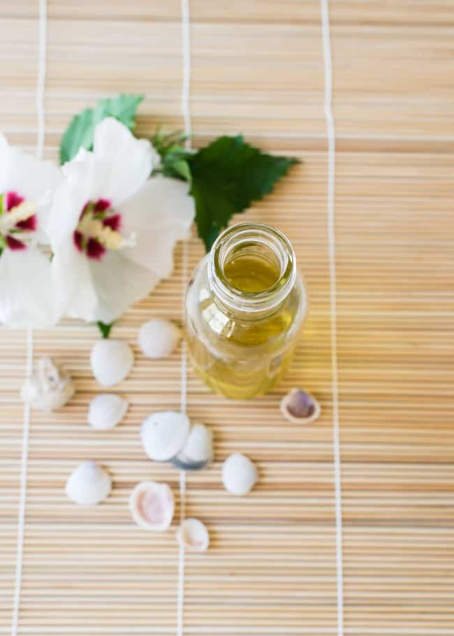 DIY Coconut Body Oil with Natural SPF | Hello Glow