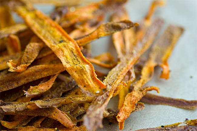 Curried baked carrot chips by Oh My Veggies   30 Healthy Chip Recipes