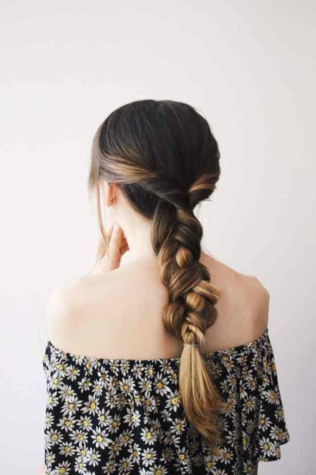 Basic braid with a twist - 11 Braided Ponytail Tutorials Perfect for Fall