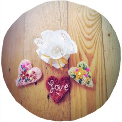 tie a piece of yarn around the doily with your little heart brooch inside. the prefect little gift!