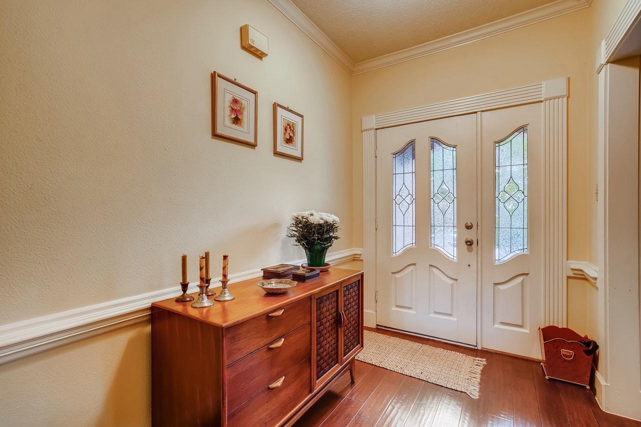 mid century modern cabinet in entryway foyer