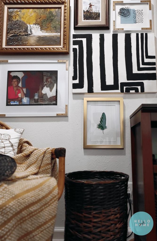 gallery wall with dark brown basket hiding a paper shredder