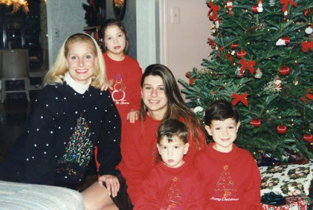 Wearing Christmas sweaters in 1995 by the tree by Robin LaMonte/Rooms Revamped Interior Design