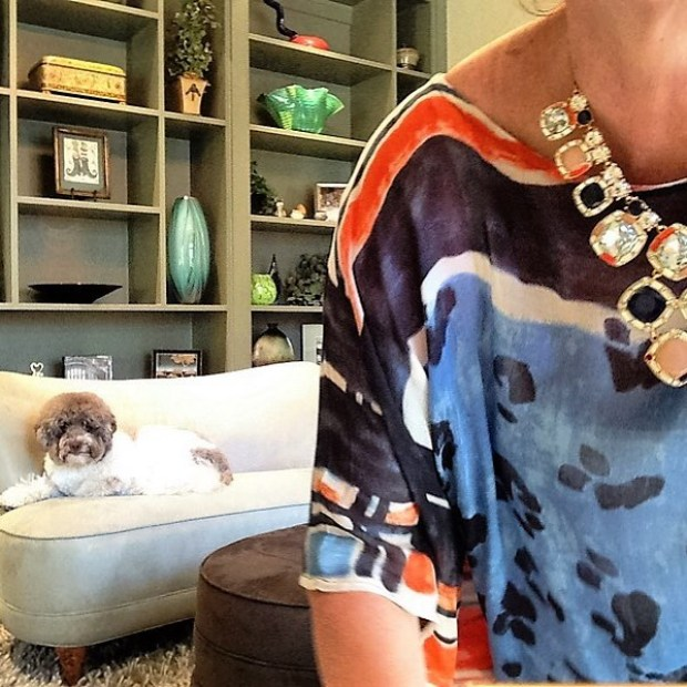Robin LaMonte is wearing a fabulous blue and orange poncho top from Chico's with this fabulous Kate Spade necklace