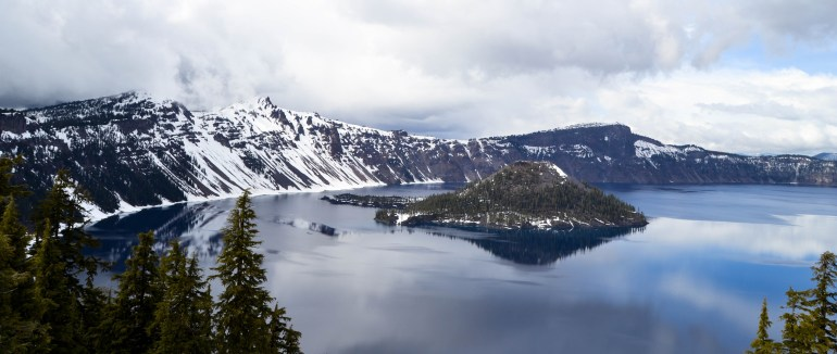 Crater Lake National Park. view of lake and Wizard Island,  shrouded in snow.