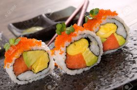 36495504-California-roll-sushi-with-caviar-on-a-black-plate-Stock-Photo