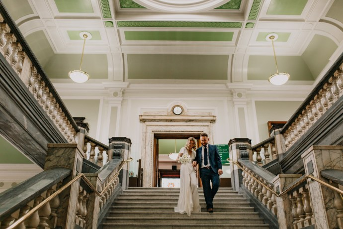 Islington town hall married couple descending staircase