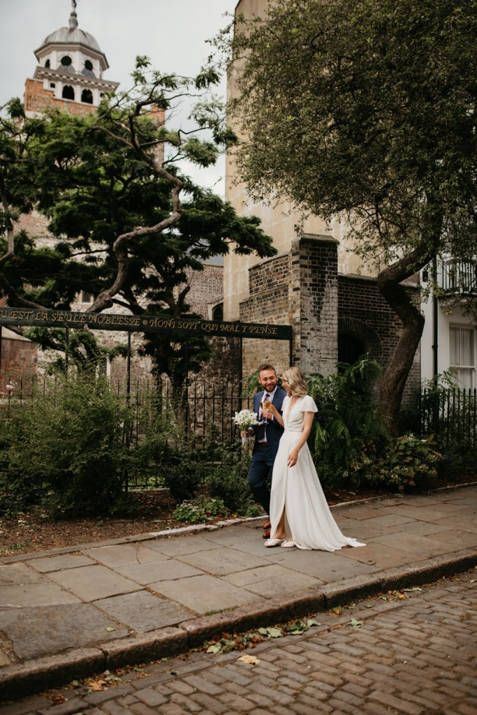 London Wedding Photo at Charterhouse Square with cobbled streets and heritage buildings behind
