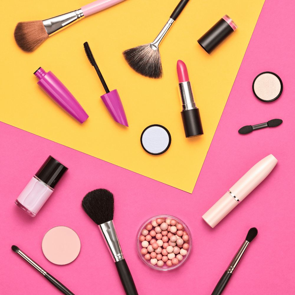 assorted makeup on a yellow and pink background