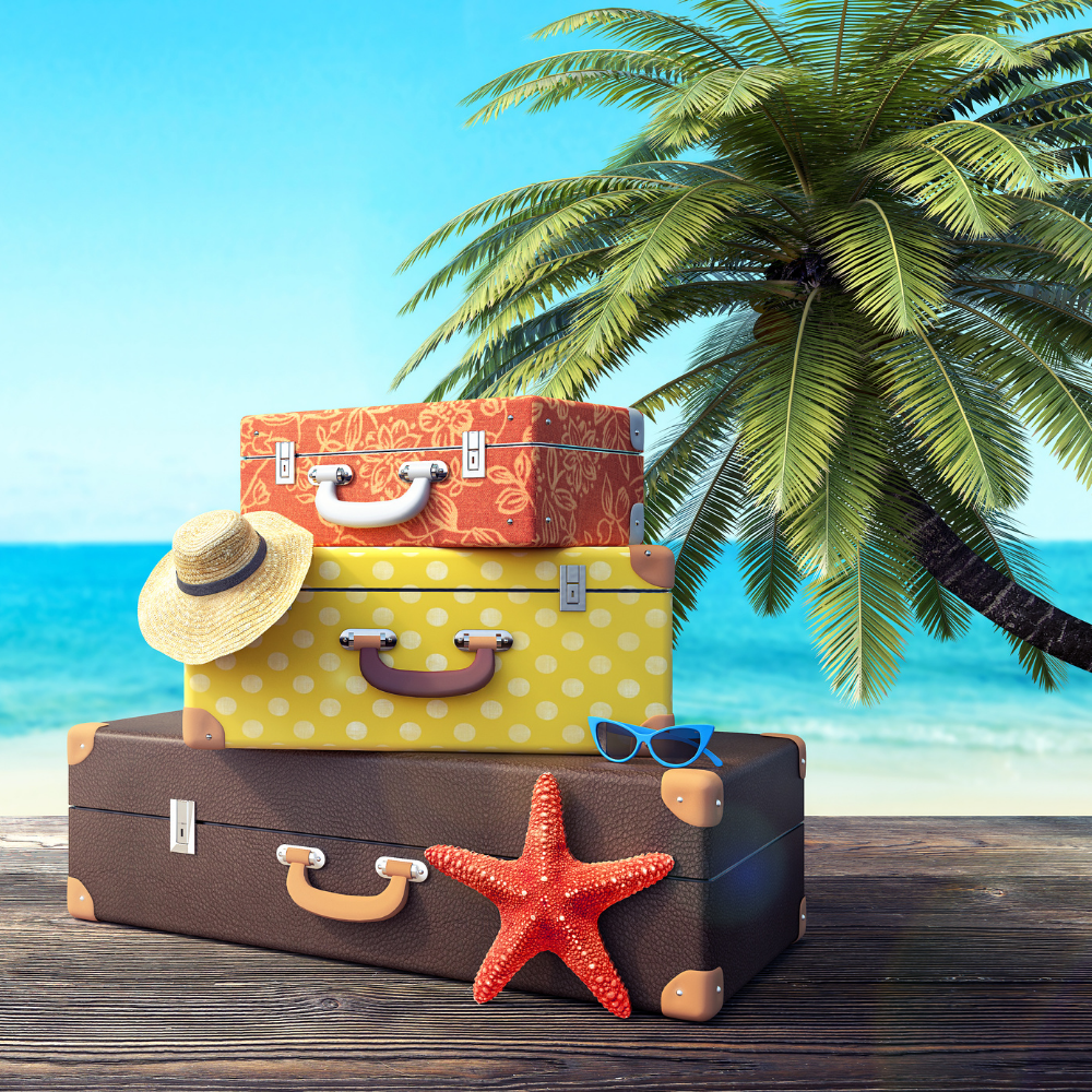 old fashioned suitcases stacked in front of a beach scene