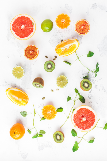 Assorted bright-coloured fruit on a white background