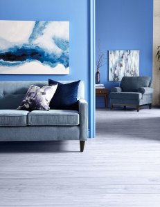 crystal-inspired decor: blue sofa and chair and wall art