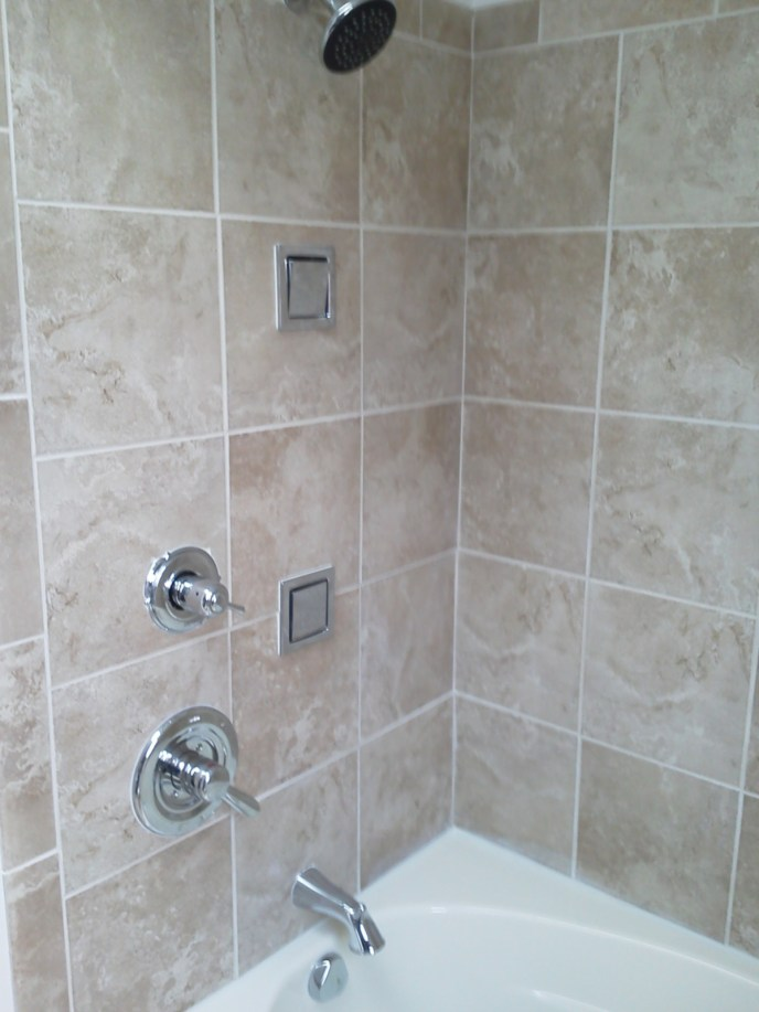 Pittsburgh residential bathtub shower stall with shower diverter, transfer valve, tub spout, and shower head with body spray assemblies there are three total for the person to spray head neck and torso