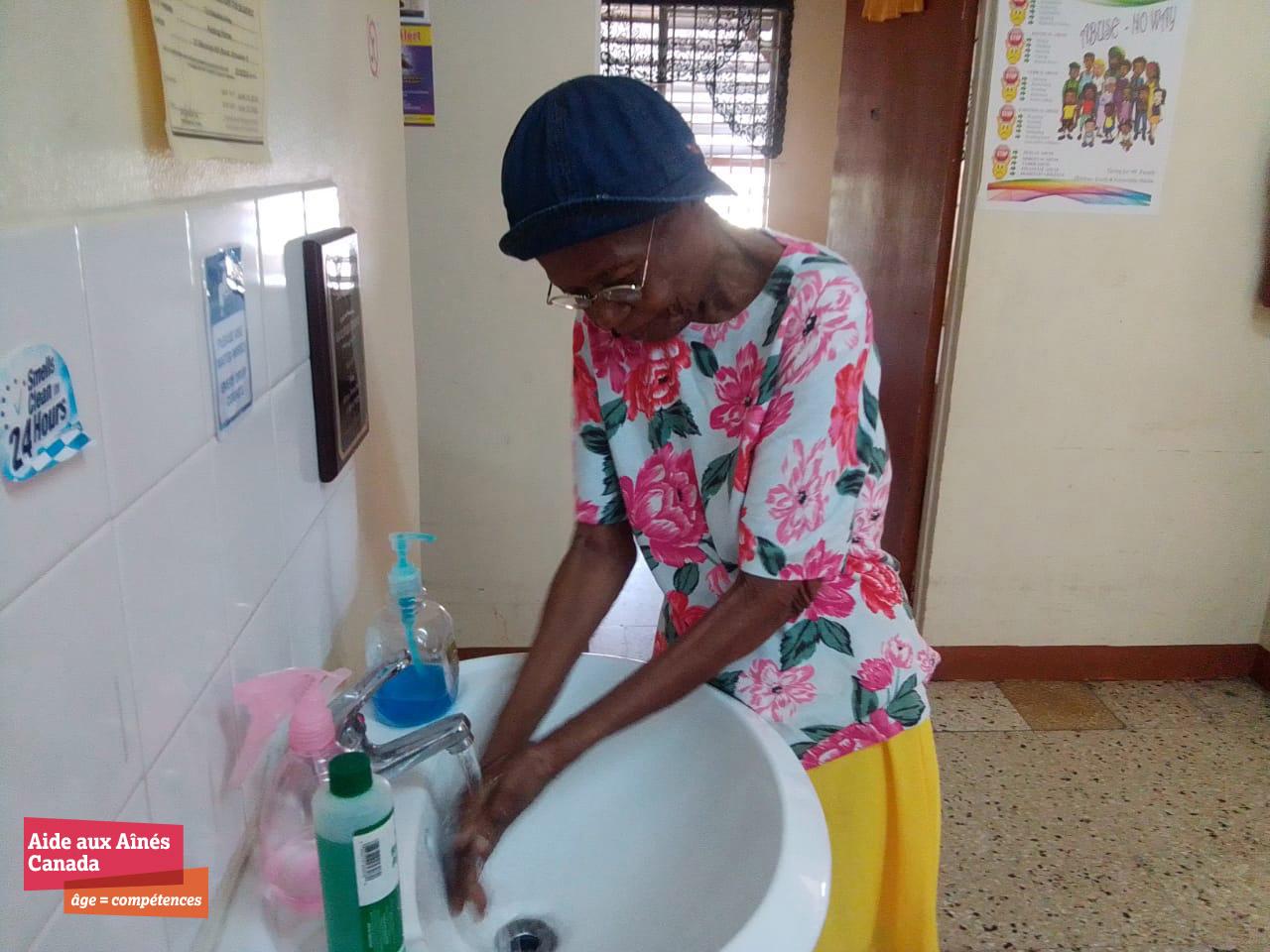 Senior Practicing Good Hand Washing Techniques Frlogo