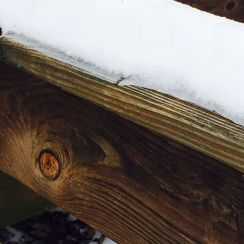 Snow on Deck Rail - Knotty Board - Copy
