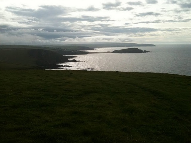 A view over Bigbury Bay. Clouds lour over Salcombe.