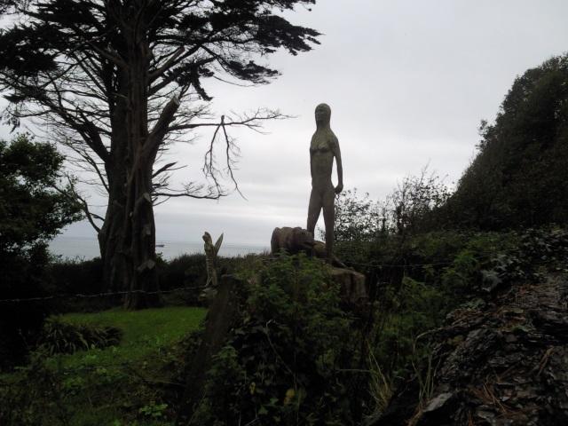 Strange wooden sculptures in someone's garden in Hallane