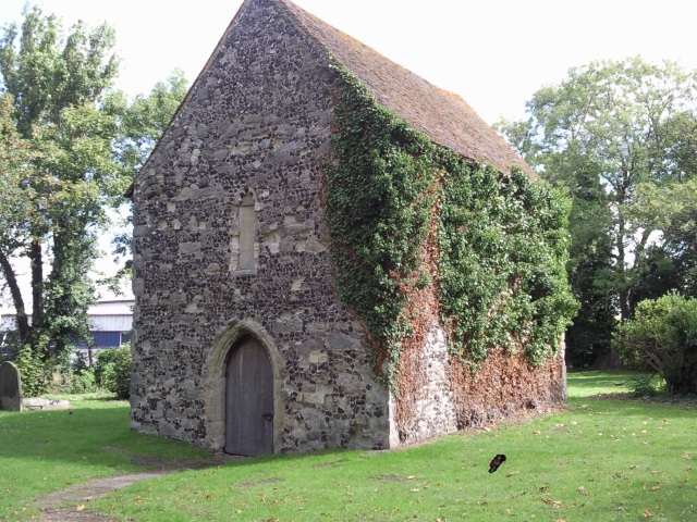 The ruined church at Murston, ivy covering one side.