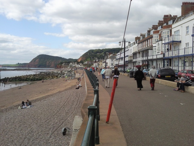 Sidmouth seafront, featuring a promenade and sandy beach