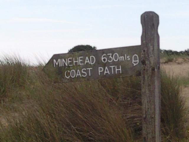 Sign: Minehead 630 mls Coast path
