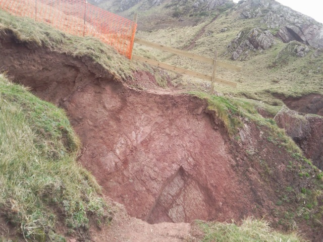 A chasm severing the path due to a landslip