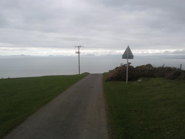 A road seemingly aiming across the sea towards the Lleyn Peninsula