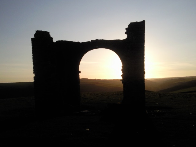 The Warren Tower, silhouetted against the sunrise