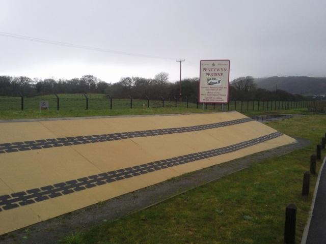 An arty tyre-tracks-on-sand embankment design