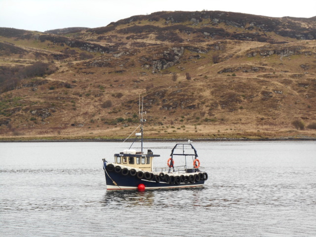 Small boat with the Isle of Bute behind