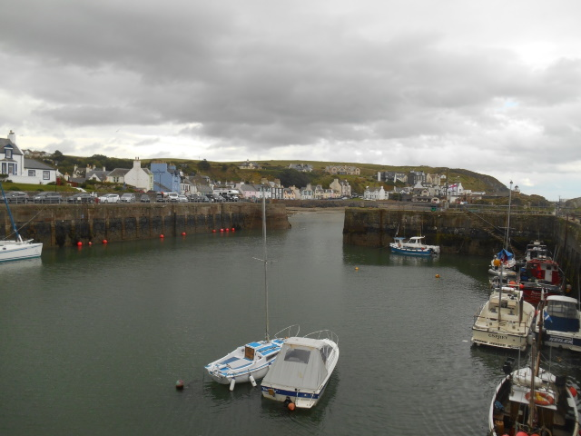 Portpatrick harbour containing a few small boats