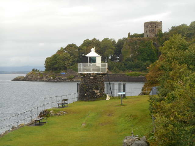 Dunollie Lighthouse with Dunollie Castle behind