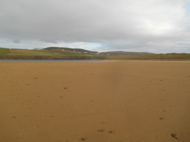 Broad, flat beach and River Naver with Bettyhill behind