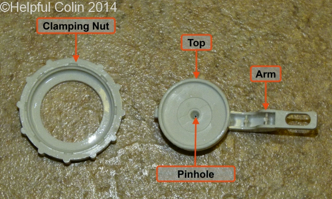 The Top Cover Assembly of Toilet Silent Fill Valve with its parts labelled and the Clamping Nut Detached. This shows the insidde of the Top Cover with the Pinhole viiible.