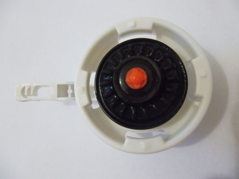 The underside of the Top Cover of the new style Toilet Silent Fill Valve with the diaphragm in place showing its 18 ridges.