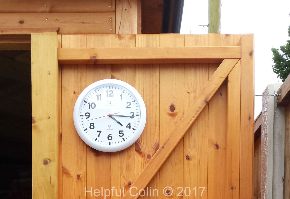 Radio Controlled Wall Clock On Shed Door