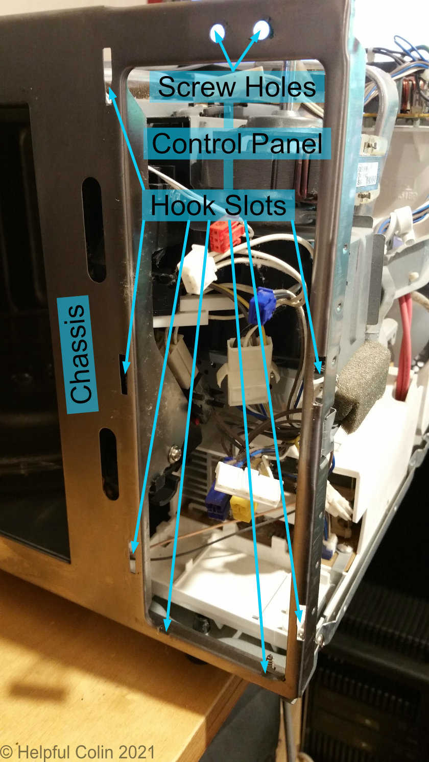 The Chassis holes and slots for the Control Panel screws and hooks