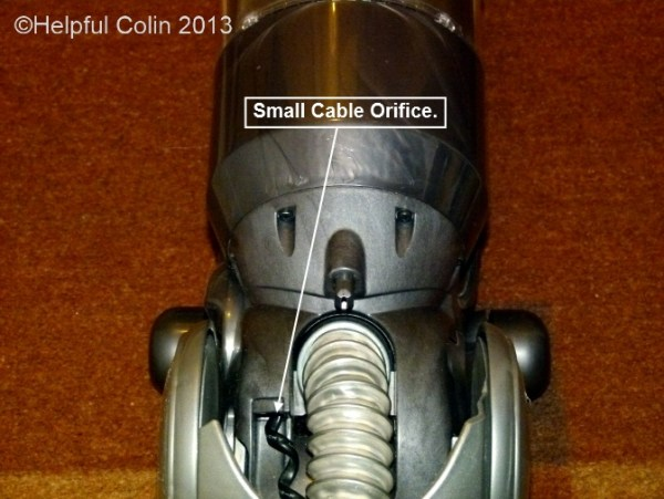 Location of the Small Cable Orifice on the Dyson Slim DC18.