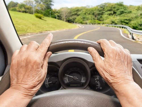 Picture of a senior with hands on the wheel