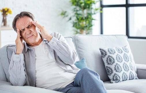 Man with a headache.