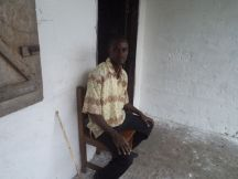 Principal Varney Gibson sitting in front of the school