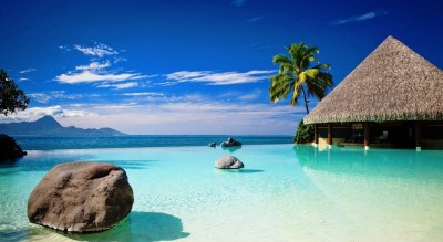 bungalow-in-blue-ocean-water-wallpaper