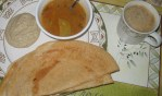 Dosa with chutney, sambhar, and a cup of piping hot coffee