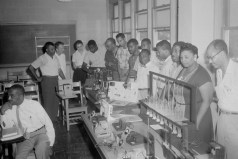 Classroom. Men and women gathered around classroom lab tables with equipment, ca. 1947. Paul Henderson, HEN.00.B2-248.