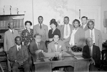 Juanita Jackson Mitchell (standing, second from left), Dr. Lillie May Carroll Jackson (standing, fourth from left) with others. Possibly the Afro-American newspaper office. Paul Henderson, undated. Maryland Historical Society, HEN.00.A2-151.