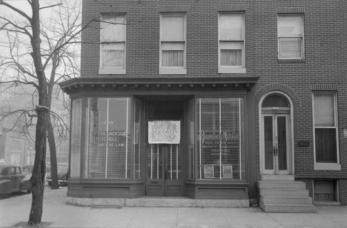 Exterior of office of Juanita Jackson Mitchell, Attorney at Law, and Jackson & Mitchell, Real Estate Agents, Property Management, Insurance, Notary Public. Sign for zoning permit on door. Paul Henderson, 1951. Maryland Historical Society, HEN.00.B1-044.