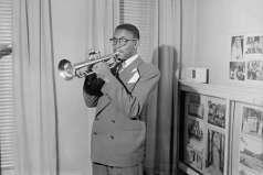 Unidentified man playing trumpet, circa 1949. Paul Henderson, HEN.00.A2-258.