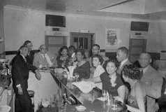 Unidentified men and women inside unidentified bar or club, circa 1953. Paul Henderson, HEN.00.B1-095.