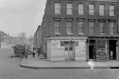 Exterior of Lexington Barber Shop and building with public notice for permit for tavern, circa 1949. Paul Henderson, HEN.00.B1-105.
