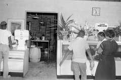 Interior of delicatessen or grocery, circa 1948. Paul Henderson, HEN.00.B1-128.